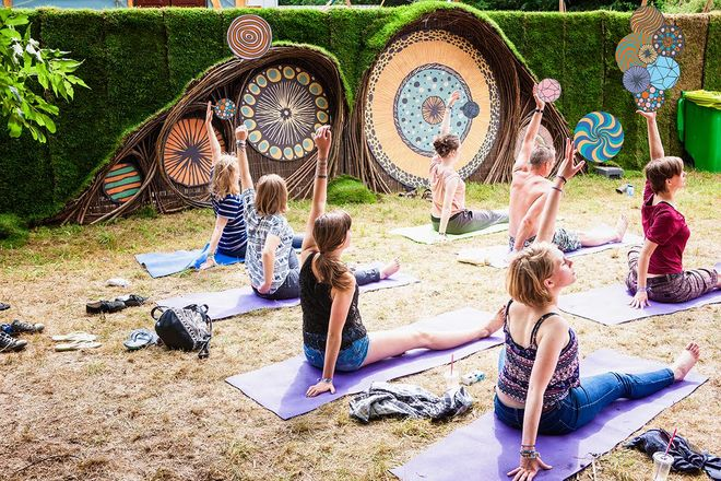 IMAGE: Photo –Down the Rabbit Hole festival –fence and yoga
