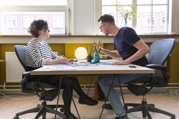 IMAGE: Photo – Jurjen and Ashley working at desk