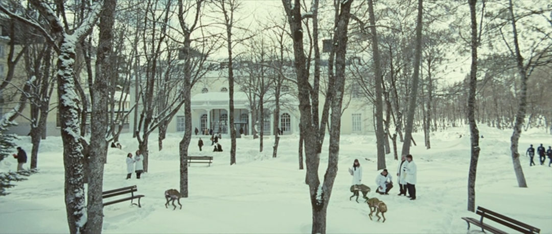 IMAGE: Still from Eva – Snow landscape and robots